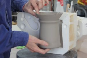 Removing slip cast stein mug from mold